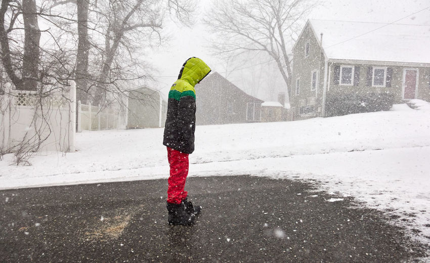 Winter Snow Cold Temperature Warm Clothing Real People One Person Built Structure Architecture Child Building Exterior Childhood Nature Clothing Tree Day Full Length Standing Snowing Lifestyles Extreme Weather Outdoors Boy