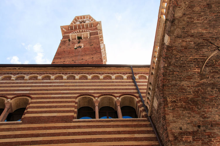 Lamberti Tower - Verona - Italy Arch Architecture Arena Bell Tower - Tower Brick Building Exterior Built Structure City Clock Tower Coluseum Day Entrance Façade Famous Place History Italy Low Angle View Outdoors Place Of Worship Romeo And Juliet Sky Tall - High The Past Tower Verona