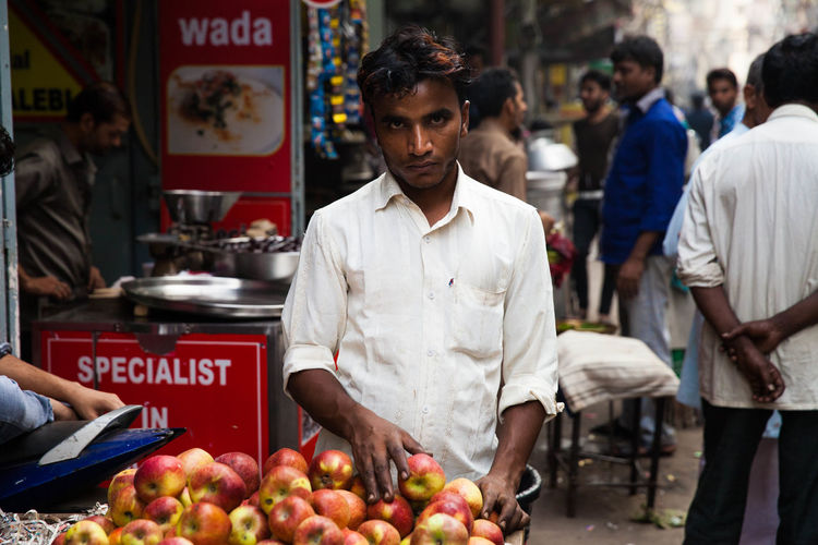 India Indian Culture  Indian Street New Delhi Man Selling Man Selling Fruit On A Bicycle Man Selling Fruits In India Serios Man