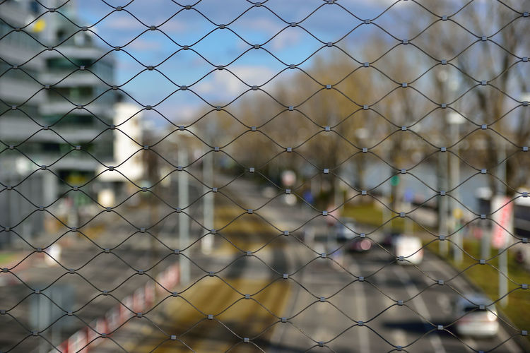 Streetphotography Street Architecture City Road Sky And Clouds Tree Chainlink Fence Close-up Day Focus On Foreground Full Frame No People Outdoors Pattern Protection