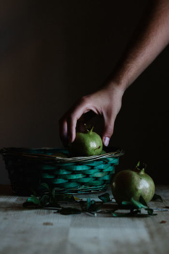 Person Taking Fruit From Basket