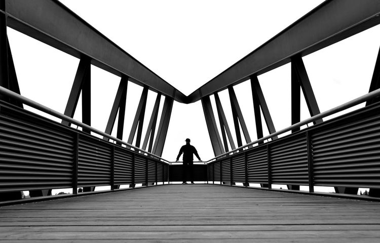 All the world`s a stage... Architecture Black & White Black And White Blackandwhite Bridge Bridge - Man Made Structure Built Structure Conceptual Day Exceptional Photographs EyeEm Black&white! Footbridge Long Goodbye Minimalism Minimalobsession Monochrome Monochrome Photography One Person Outdoors Railing Rear View Symmetrical The Secret Spaces The Way Forward Urban Geometry The Graphic City