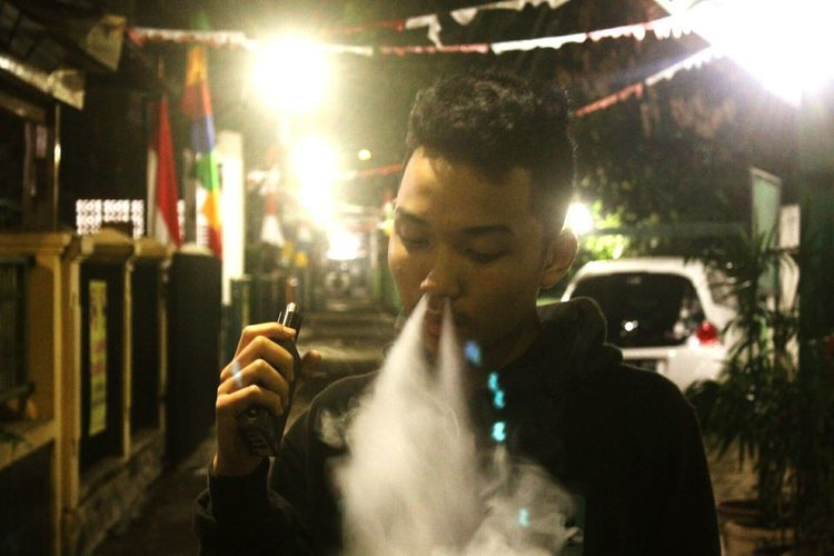 Man emitting smoke from nose