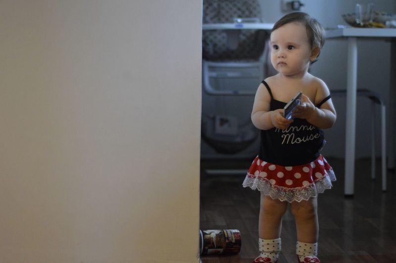 Full length of cute girl standing at home