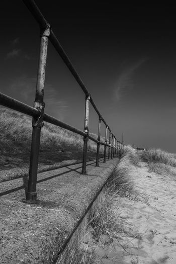 Disappearing down the beach Beach Caister Cloud - Sky Day Diminishing Perspective Dunes Fence Landscape Metal Metallic Nature Outdoors Railing Sky
