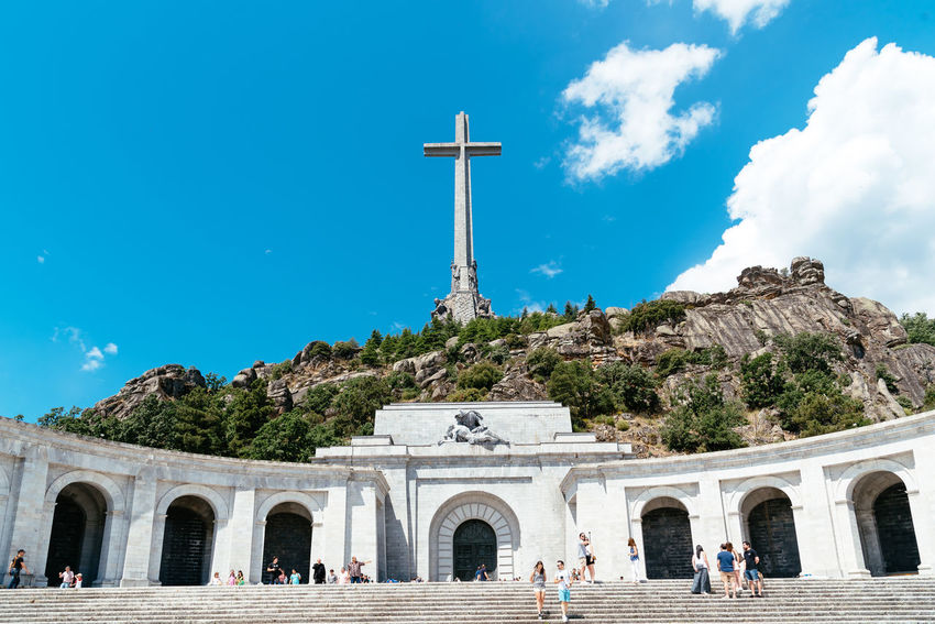 Basilica and big cross in the Valley of The Fallen in Madrid Basilica Cross El Escorial Madrid SPAIN Spanish Civil War Tomb Architecture Belief Building Exterior Built Structure Cross Europe Exhumation Franco History Nature Outdoors Place Of Worship Politics And Government Religion Sky Spirituality Travel Valley Of The Fallen