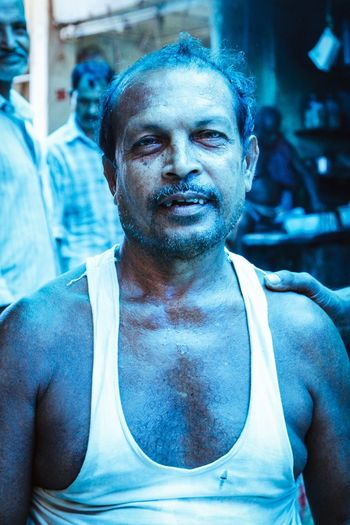 India Portrait Men Crowd Illuminated City Colorful Urban Eye4photography  The Week Of Eyeem Check This Out Streetphotography Street ASIA Documentary Blue Vscocam Kolkata City Life Travel Photography VSCO Colours Journey EyeEm Best Shots Incredible India