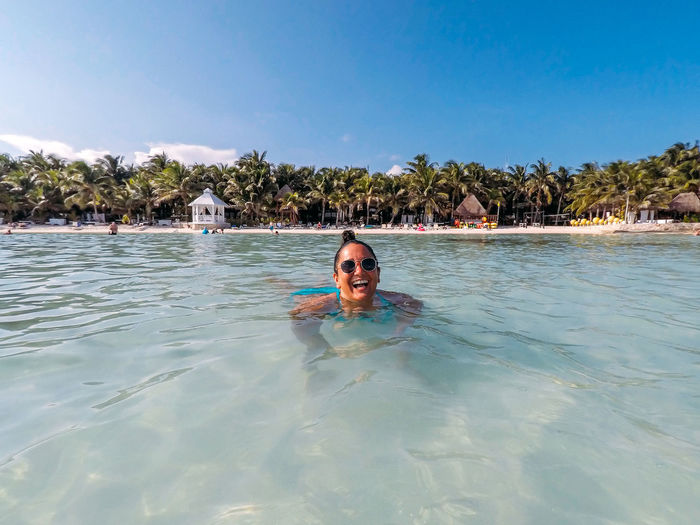 Beach Life Happy Happy People Holiday Laughing Mexico Beach Day Front View Leisure Activity Lifestyles Nature One Person Outdoors Pool Portrait Real People Summer Swimming Swimming Pool Vacation Water Waterfront Young Women