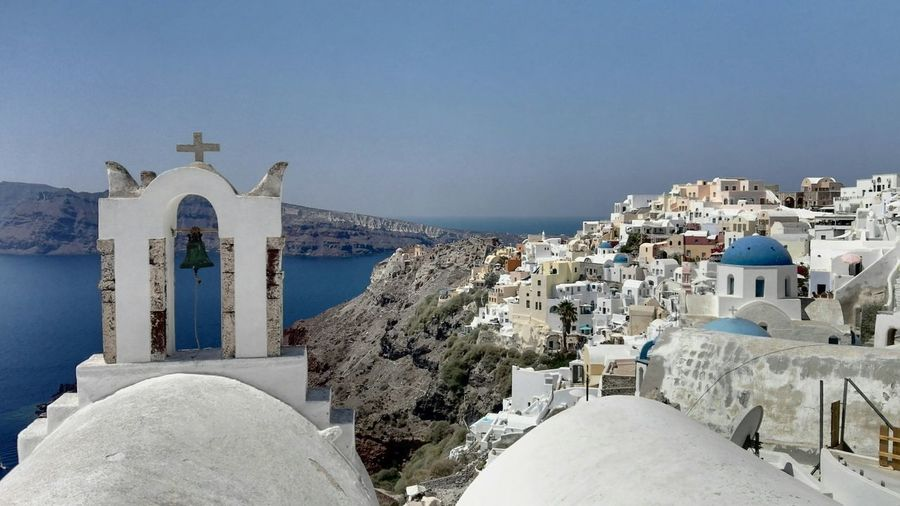 Town by sea against clear sky at santorini