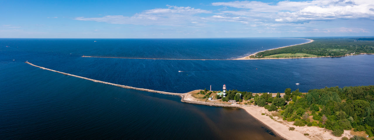 Aerial view of the lighthouse at the river bank and the sea.