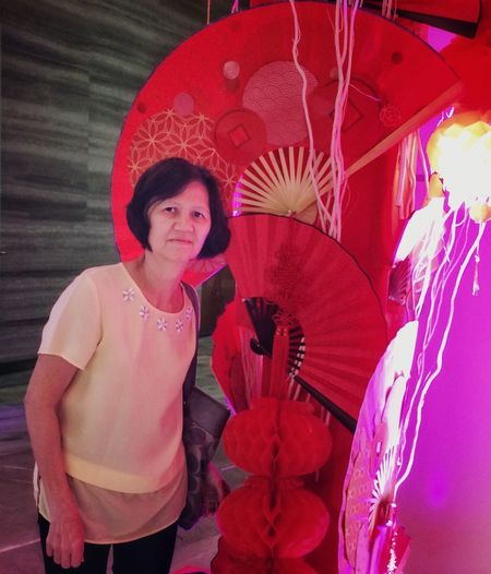 Chinese New Year 2019 Spirits Coming Of Chinese New Year Hi Spirit One Person Real People Looking At Camera Standing Traditional Clothing Portrait Clothing Adult Pink Color Women Three Quarter Length Umbrella Hand Fan Front View Lifestyles Leisure Activity Red Festival