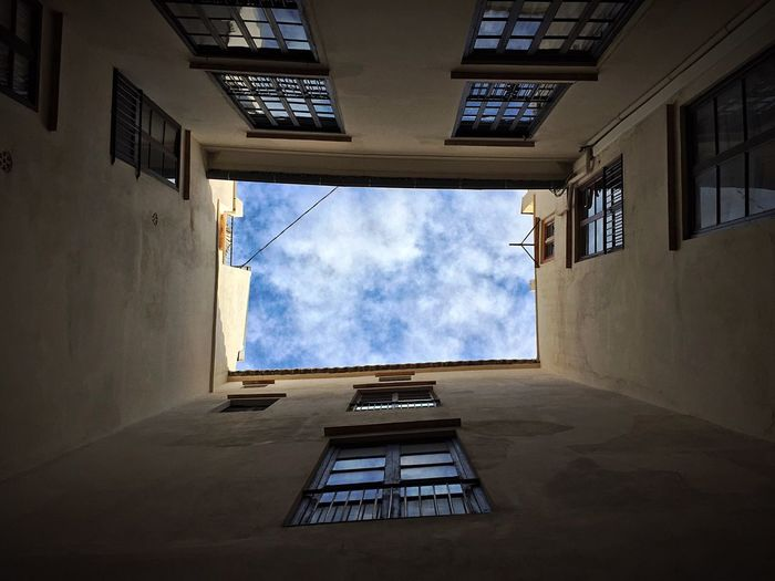 Low Angle View Of Skylight Amidst Buildings