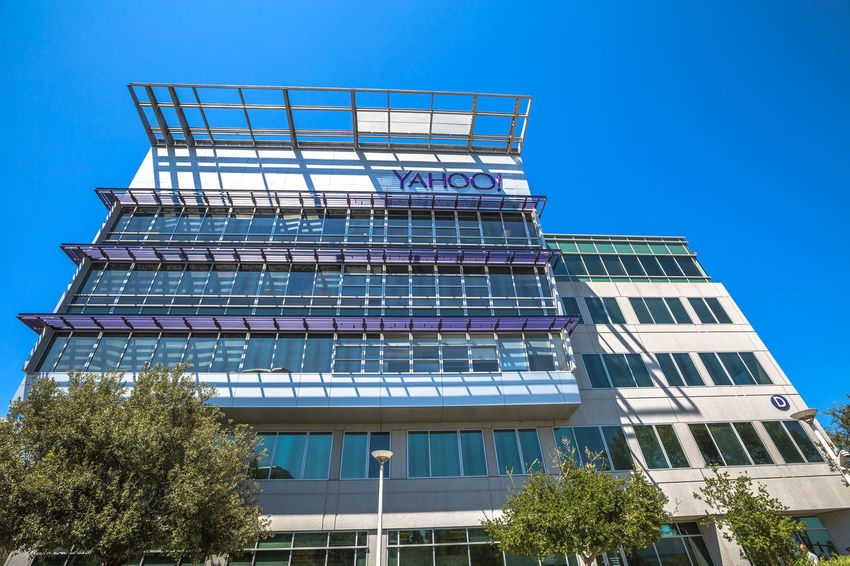 Sunnyvale, California, United States - August 15, 2016: Yahoo Headquarters facade building. Yahoo is a multinational technology company that is known for its web portal. Company Multinational Sunnyvale USA United States Yahooweather America Architecture Blue Building Building Exterior Built Structure Clear Sky Day Headquarters Hq Low Angle View Modern No People Outdoors Search Engine Sky Street Sunnyvale Street Tree Window Yahoo