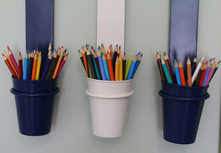 Colored Pencils In Containers On Wall