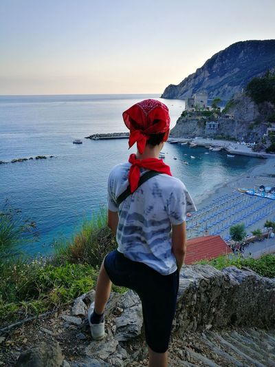 Here's the world's other most patient little hiker. Teenage Boys Hiker On Top Of The Mountain Monterosso Monterosso Al Mare Monterossoalmare Trekking #travelling #sightseeing Hiking Trail Cinque Terre Liguria Cinque Terre Monterosso Al Mare Cinque Terre Italy Cinque Terre Cityscape Cinque Terre Ports Liguria,Italy Liguriansea Ligurian Sea Ligurian Coast. Liguria Di Levante Ligurian Riviera Liguria Riviera Di Levante Water Sea Standing Rear View Red Sunset Sky Horizon Over Water