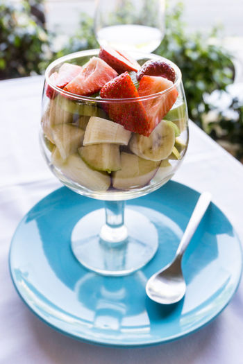 Close-Up Of Fruit Salad Served In Wineglass On Table