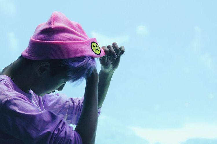 Portrait of girl wearing hat against sky
