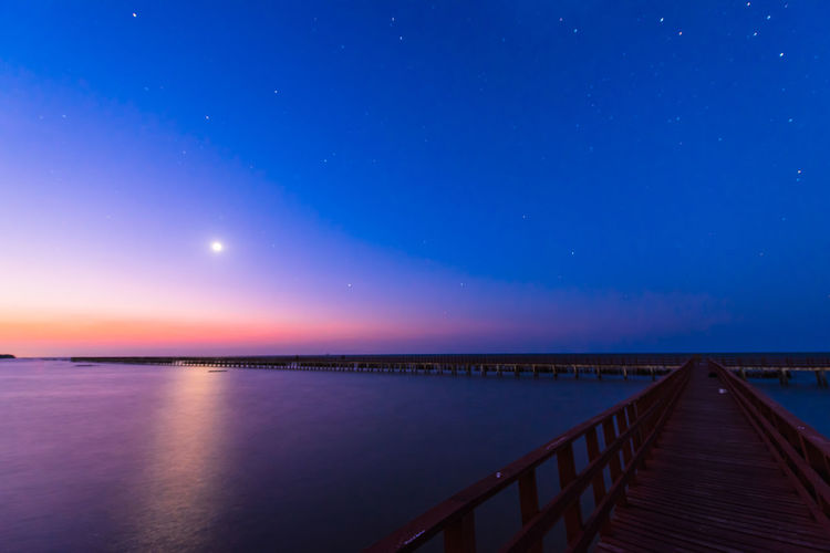 night time on wooden bridge Moon Light Nightphotography Night Twilight Wooden Bridge Astronomy Astrology Sign Space Star - Space Water Constellation Sea Beach