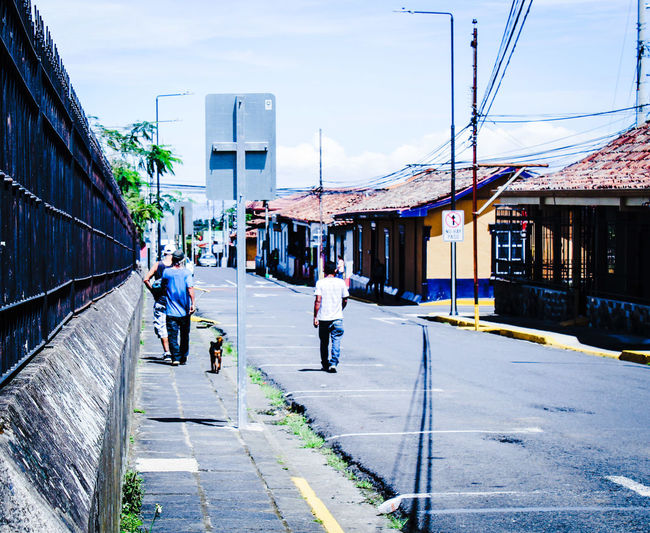Barva Dog Heredia, Costa Rica Barva Walking Around Walking Around Taking Pictures City Full Length Men Sky Architecture Building Exterior Built Structure Street Scene Road Marking Street Asphalt Roadways Yellow Line Double Yellow Line Crosswalk The Street Photographer - 2018 EyeEm Awards