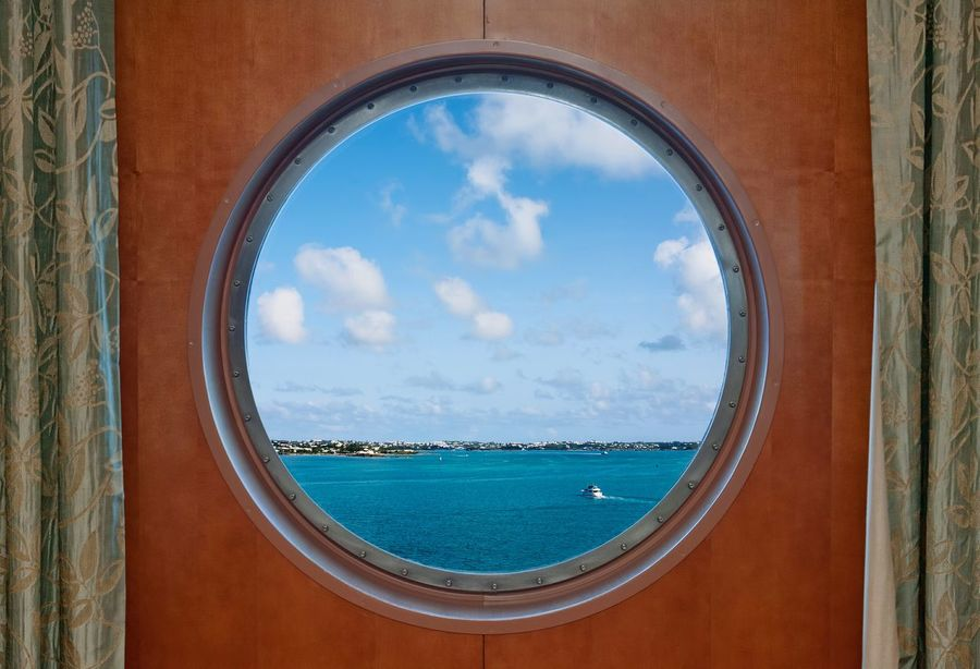 Bermuda coastline seen through the porthole of a cruise ship Window Water Porthole Portholes Bermuda Ship Ships Boat Boats Travel Ocean Oceans Coastline Tropical Cruise Ship Cruise Cruise Ships Vacation Vacations Sky Coast Curtains View Of The Sea Sea Summer