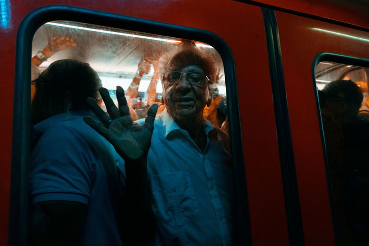 Rear view of people in train