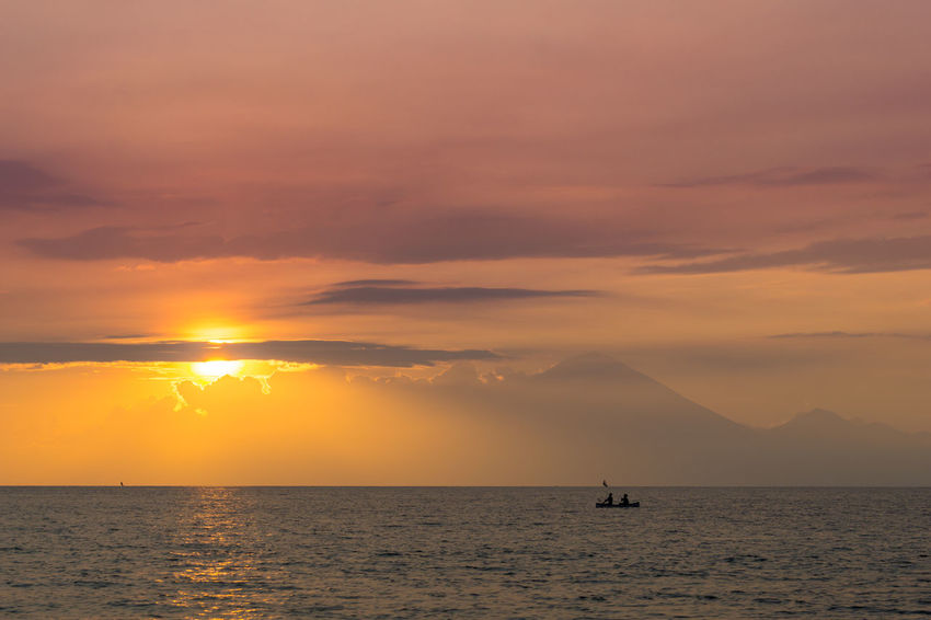 View of Mount Agong of Bali from Nipah beach in Lombok island, Indonesia. Bali Beauty In Nature Cloud - Sky Day Dramatic Sky Landscape Lombok Island Lombok-Indonesia Mount Agung Nature No People Outdoors Ray Of Light Ray Of Sun Reflection Rinjani Sea Sky Sun Sunset Sunset Silhouettes