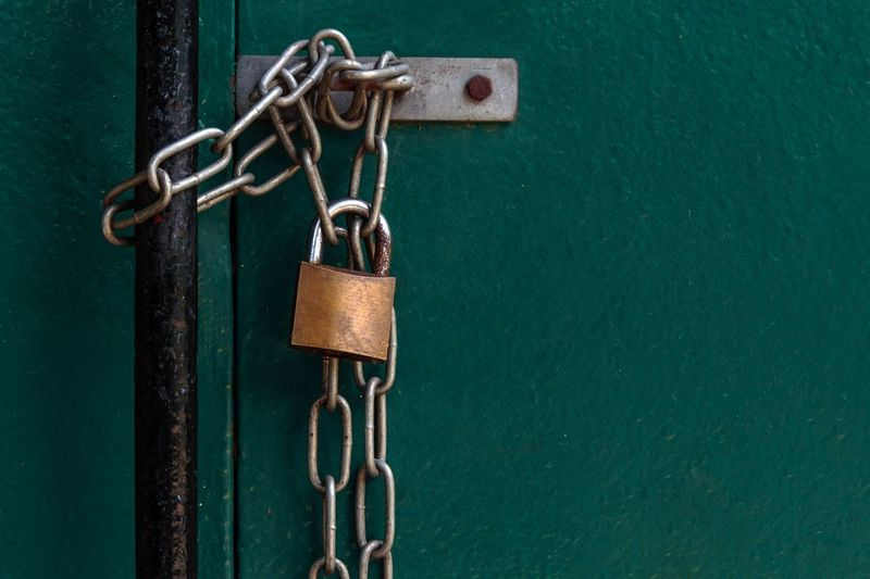 Copy Space Emotion Metal Chain Lock No People Safety Security Padlock Protection Close-up Green Color Entrance Door Closed Hanging Rusty Backgrounds Turquoise Colored Urban Scene Gate Link Releasing Safe Locked Entry Entryway Full Frame Closed Door Doorway