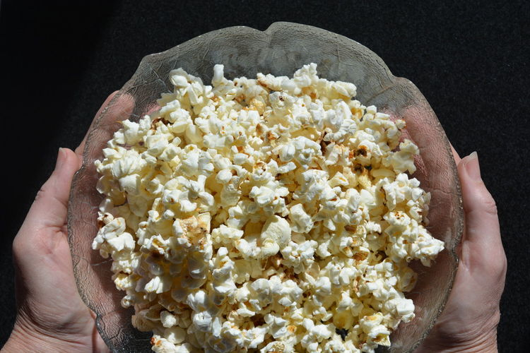 Woman holding bowl of popcorn Adult Adults Only Close-up Day Food Food And Drink Healthy Eating High Angle View Holding Human Body Part Human Hand Lifestyles One Person People Popcorn Ready-to-eat