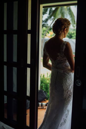 Waiting Basmanorsnz Wedding Photography Wedding Day Memories Romance Weddings Around The World Lovephotography  Wedding Dress Beautiful Sight Lovers Forever Contemplative Solitude One Person Weddingphotography Weddingshoot Wedding Vanuatu Wedding Human Back Standing Back Looking Through Window Window Rear View Silhouette Women Translucent Scene Doorway One Mid Adult Woman Only Thoughtful The Fashion Photographer - 2018 EyeEm Awards The Portraitist - 2018 EyeEm Awards