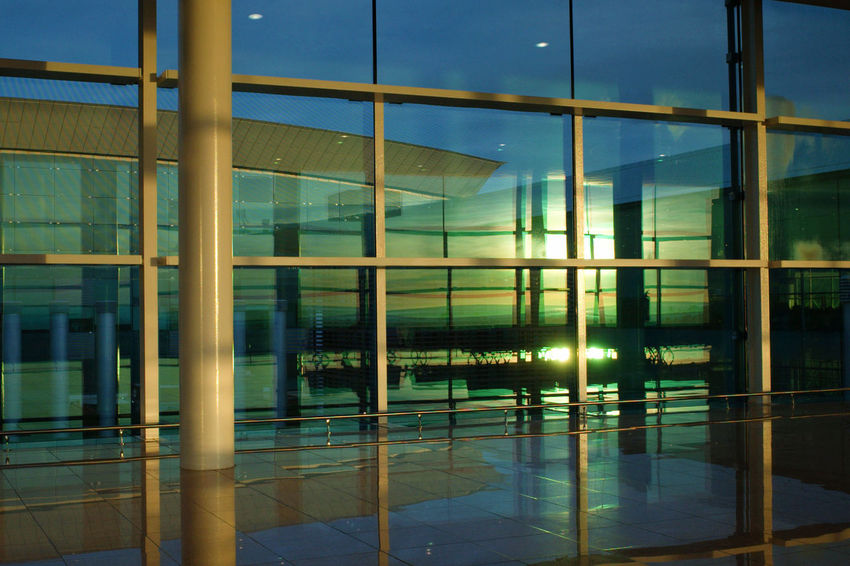 Airport Architecture Building Building Exterior Built Structure Ceiling City Flooring Glass Glass - Material Illuminated Modern Night No People Office Office Building Exterior Outdoors Pattern Reflection Transparent Window