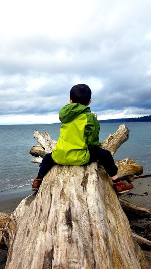 Sea Rear View Nature Tranquility Water People Beauty In Nature Scenics Outdoors Horizon Over Water One Person Sky Clouds Landscape Pacific Northwest  Driftwood Coastline Beauty In Nature Childhood Boy Adventure Makebelieve Playtime Kids Child