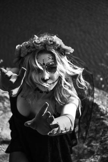 Closeup portrait of calavera catrina. black and white photo. young woman with sugar skull makeup.