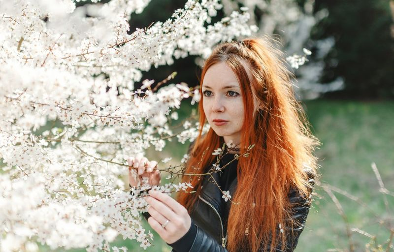 Redhead Portrait Springtime Spring Spring Flowers Spring Tree person Light 35mm F1.4 35mmfilmphotography EyeEmNewHere EyeEm Best Shots Girl Women Beautiful Woman Tree Young Women Beautiful Woman Portrait Beauty Flower Long Hair Redhead Beautiful People Grass Blooming Flower Head Plant Life Cherry Tree Orchard