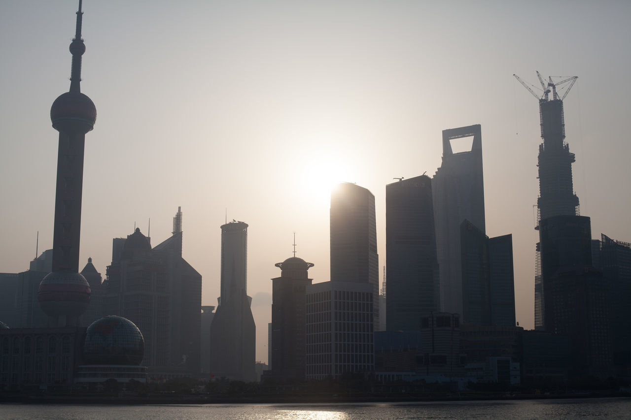 Silhouette Buildings Against Clear Sky