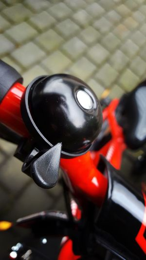 Bell Bicycle Clamp Close Up Close-up Cycling Cycling Around CyclingUnites Detail Handlebar Mode Of Transport No People Outdoors Protection Red Round Safety Selective Focus Sport Sports Steering Steering Gear Transportation Lieblingsteil