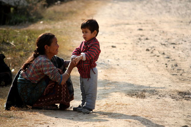 Grandmother's love - A grandmother talking to her little grandson in a small Nepali village. ASIA Family Focus On Foreground Full Length Grandmother Grandmother And Grandson Listening Little Boy Nepal People Squatting Talking Travel Photography Showcase June People And Places Focus On The Story