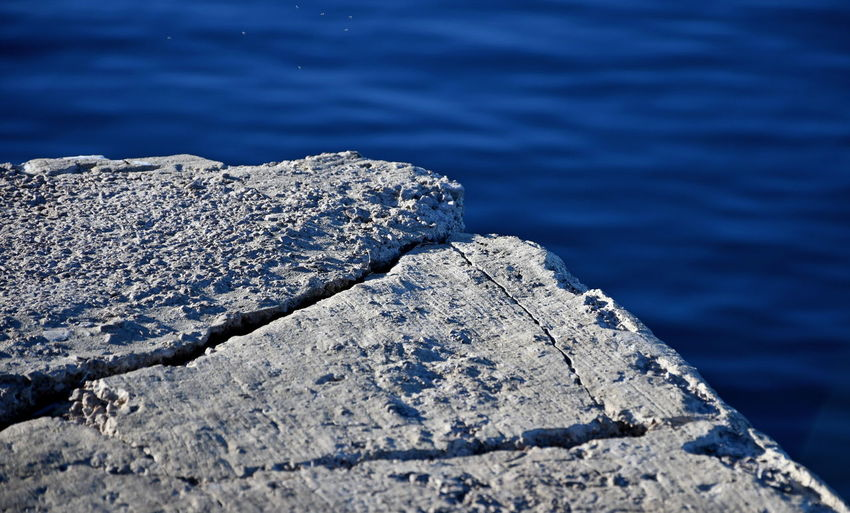 Close-up of rock by sea