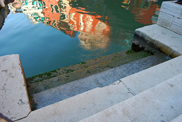 High angle view of wall by lake