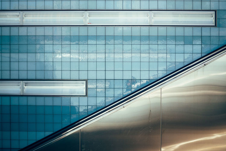 up Architectural Feature Architecture Blue Building Exterior Building Story Built Structure City Life Day Escalator Full Frame Getting Inspired Modern No People Office Building Reflection Tiles The City Light The Architect - 2017 EyeEm Awards