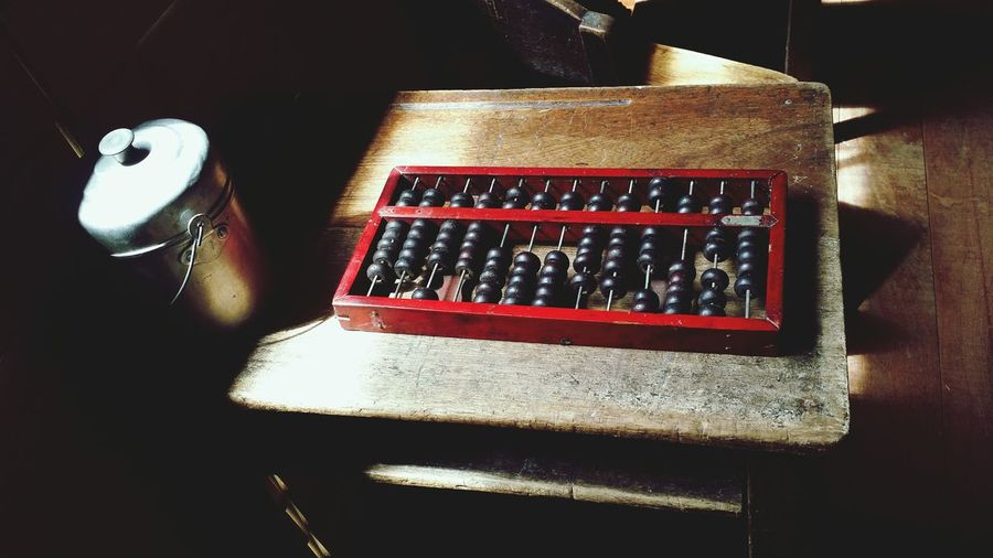 Close-up of abacus on table