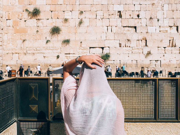 Rear View Of Woman Praying Against Men Section At Western Wall