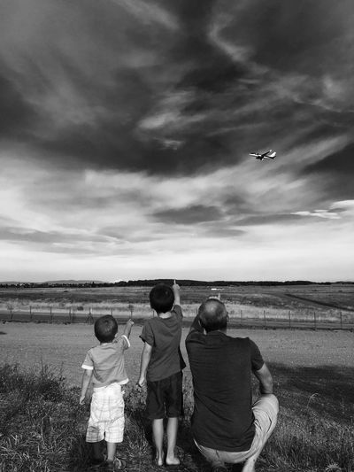 Fatherhood Moments Outdoors Famille Person Plane Father Father & Son Fatherandsonmoments Sky Eyeemphotography EyeEm Gallery Unrecognizable Person Black And White Culture Of The Holidays The Culture Of The Holidays