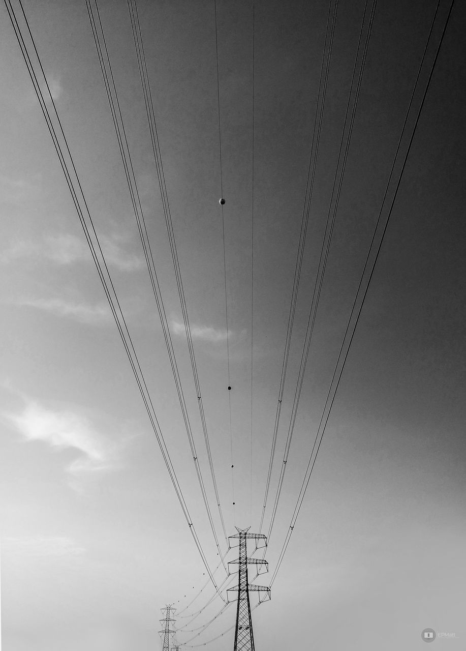 LOW ANGLE VIEW OF OVERHEAD CABLE CAR