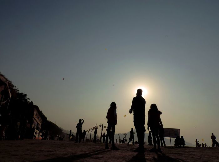 Kite Flying Afternoon Beach Festival Brahmaputrariver Enjoyment Father And Daughter Festival Kite Festival Kite Flying Low Angle View Outdoors Silhouette Sky And Clouds Sun And Sky And San Togetherness Winter