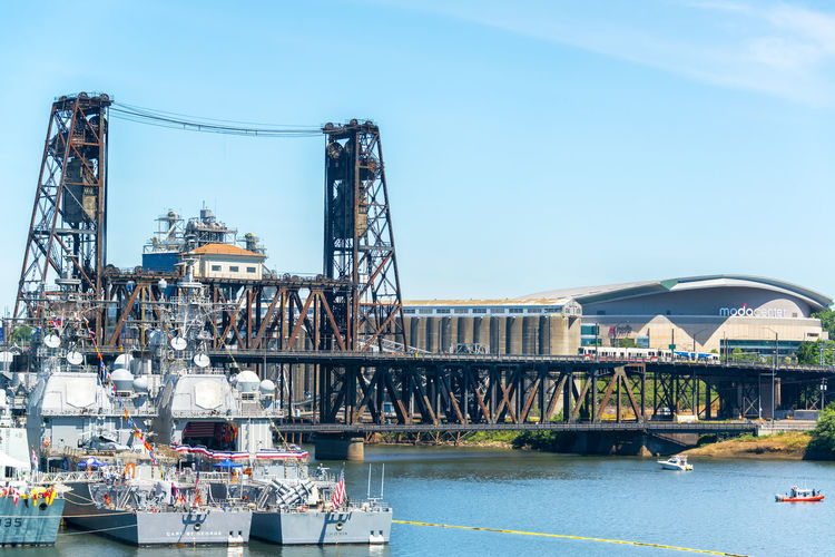PORTLAND, OR - JUNE 6: Navy ships in Portland, Oregon as part of the festivities for the Rose Festival on June 6, 2015 Bridges Building Coast Guard Colors Downtown Fleet Week Military Mods Navy Navy Ships Northwest Oregon Outdoors Pacific Portland Portland, OR Rose Festival Ship Steel Bridge Street Structure Turret United States USA Waterfront