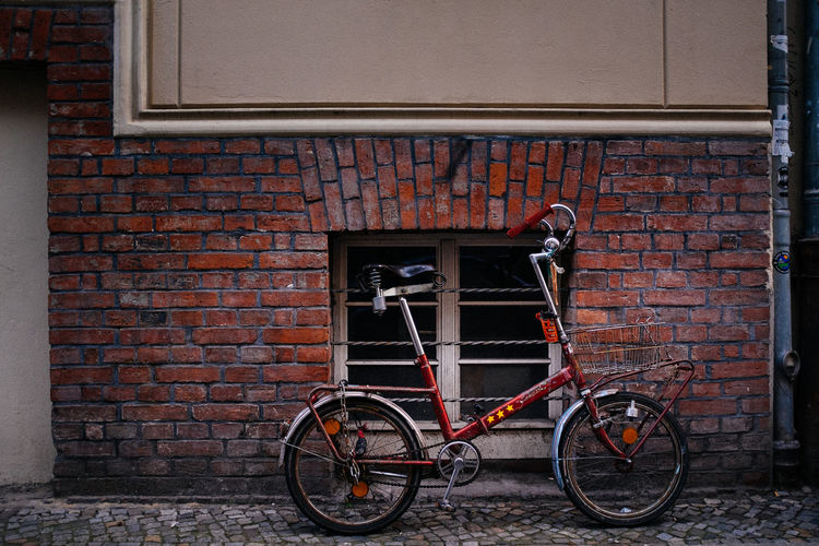 Parked leaning on brick wall