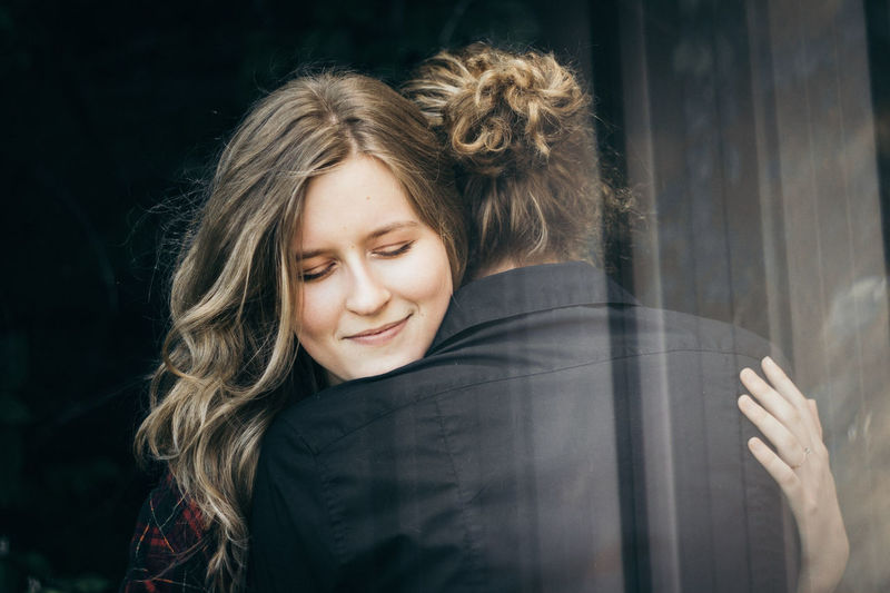 Love. One Woman Only Only Women Beautiful Woman Long Hair Adult Adults Only One Person Beauty Smiling Beautiful People People Women Winter Headshot Eyes Closed  Cold Temperature Portrait Curly Hair Young Women Cheerful Couple Couple - Relationship