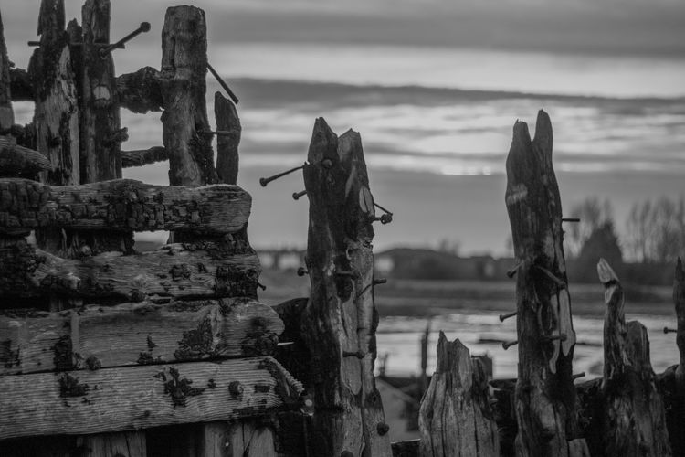 Old Ruins Of Boat Against Sky