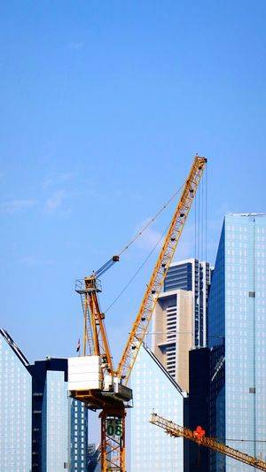 🏙 Architecture Crane - Construction Machinery Building Exterior Built Structure Machinery Sky Construction Industry Construction Site Development City Industry Building No People Day Clear Sky Blue Construction Equipment