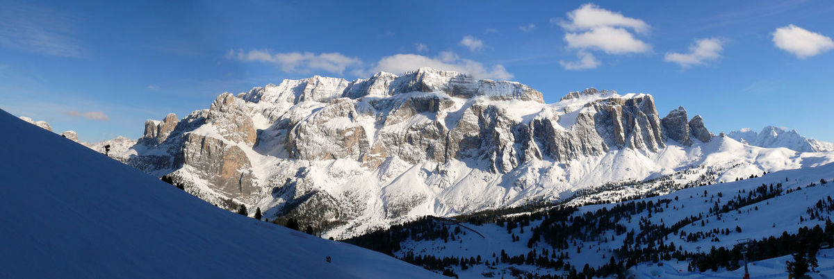 dolomites panorama Dolomites, Italy Panoramic Rock Beauty In Nature Blue Blue Sky And Clouds Cloud - Sky Cold Temperature Day Forest Landscape Mountain Mountain Peak Mountain Range Nature No People Outdoors Scenics Sky Snow Snowcapped Mountain South Tirol White Color Wilderness Area Winter
